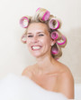 woman with curlers in bathtub