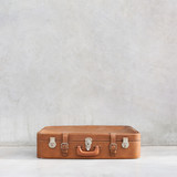 Fototapety old vintage suitcase in the concrete light room