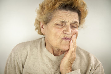 Senior woman having teeth ache