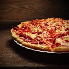 round pizza on wood background