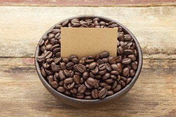 Coffee beans on wooden bowl