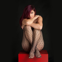 Sensual redhead woman beauty portrait against black background.