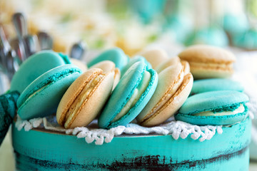 colored macaroon on gift box