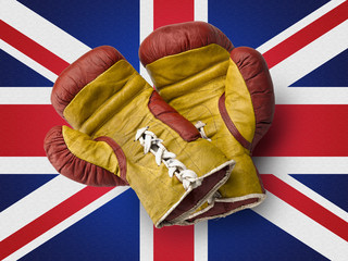 Red and Yellow boxe gloves on union jack flag