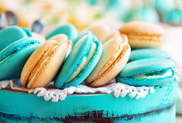Colored macaroon on gift box. Photo toned style