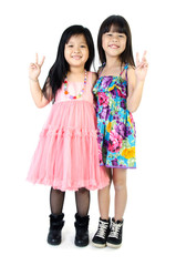 portrait of two asian happy sisters having fun