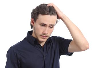 Worried depressed man with the hand on the head