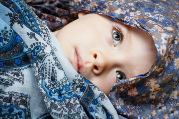 Little girl hidden in scarf