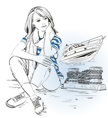 Young stylish girl on a pier against sea and yacht