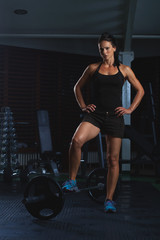 Beautiful Fitness Woman working out in the gym