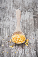 Organic peeled mung beans on a wooden spoon