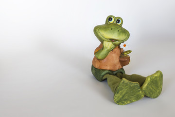 Ceramic statue of cheerful Frog with flower