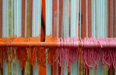 wool weavings of many colors in the old textile loom