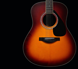 Sunburst Acoustic Guitar Body on Black Background