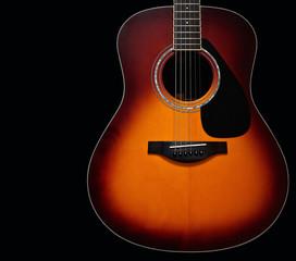 Sunburst Acoustic Guitar Body on Black Background