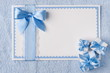 Blank greeting card with gifts in blue
