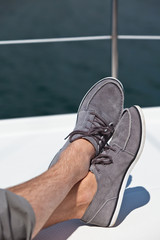 A pair of hairy man legs in topsiders