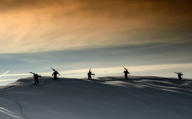 Silhouettes on the mountain top