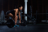 Beautiful Fitness Woman preparing to lift some heavy weights.