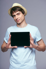 Man showing tablet screen smiling