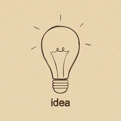 Light bulb over carton paper in doodle style. Idea symbol