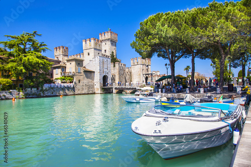 medieval castle  Sirmione on lake Lago di Garda - 66340439