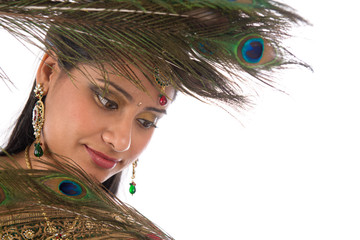 Indian female with peacock feathers.