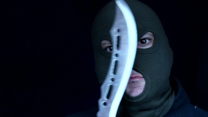 Man in a mask holding knife