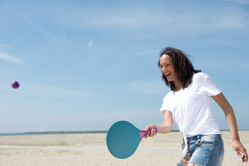 Woman playing paddle ball