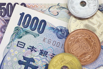 close - up japanese currency yen bank note and coin