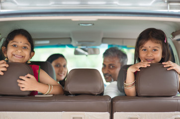 Indian family sitting in car