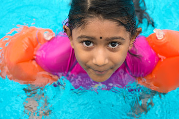 Indian child swimming