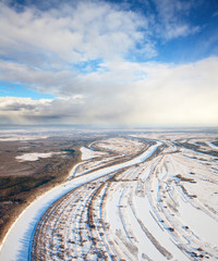 Snow covered plain with river
