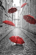 "Постер, картина, фотообои ""Red umbrellas flying on the street. Conceptual image"""