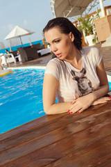 Young pretty girl in bikini in outdoors pool.