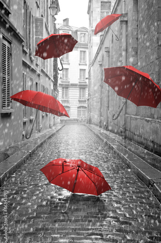 Aluminium Parijs Red umbrellas flying on the street. Conceptual image