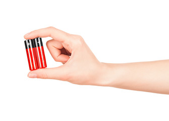 hand holds a red AA battery on an isolated white background