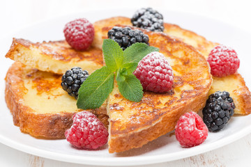 French toast with fresh berries, mint and powdered sugar