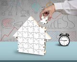 Assembling puzzles for house shape in office - 66344265