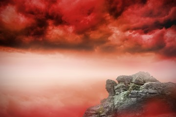 Large rock overlooking red sky