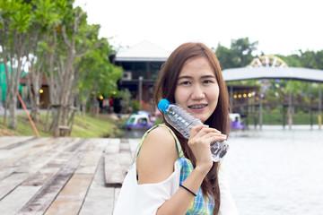Beautiful girl hold water bottle
