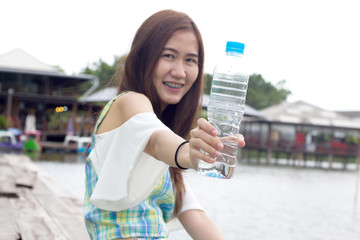 Beautiful girl hold water bottle