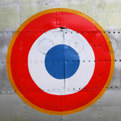 France air force insignia on a historic plane.