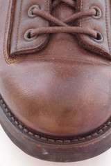 close - up men brown leather boots detail