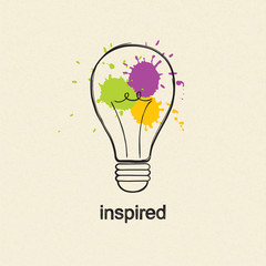 Light bulb in doodle style with colored paint splashes