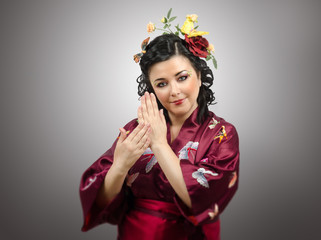 Flowers haired kimono woman showing traditional gestures