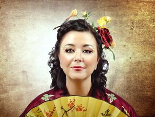 Face portrait of a stylized kimono woman with fan