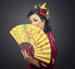 Kimono white woman holding traditional fan
