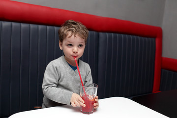 Boy drinking fruit drink