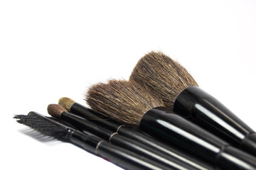 Brushes for the application of cosmetics